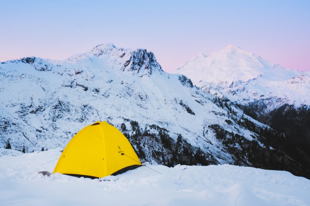 Ultimate Guide to Winter Hiking and Camping - winter tent sunrise