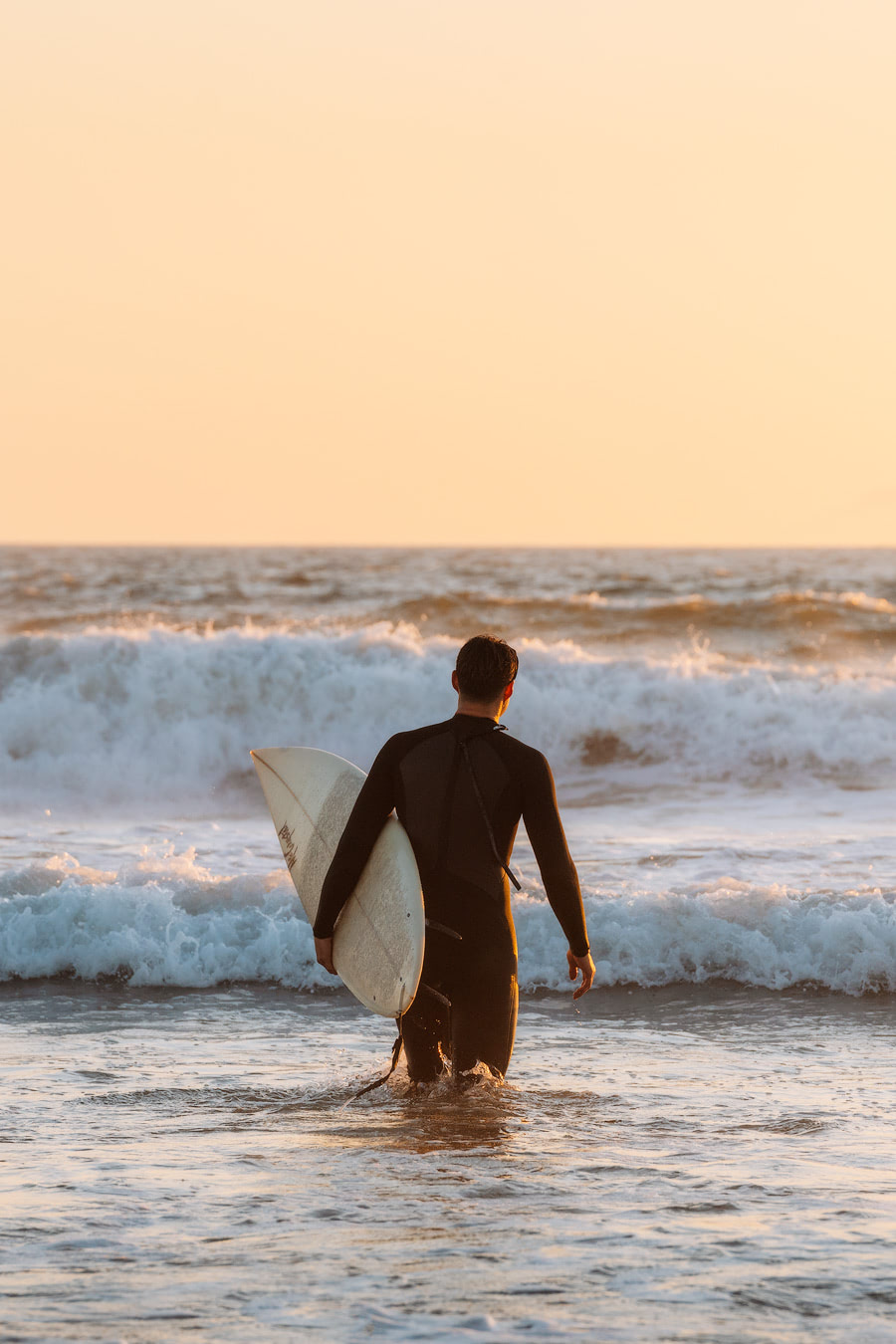 Orange County Travel Guide Everything You Need to Know- Huntington Beach Surfer 3